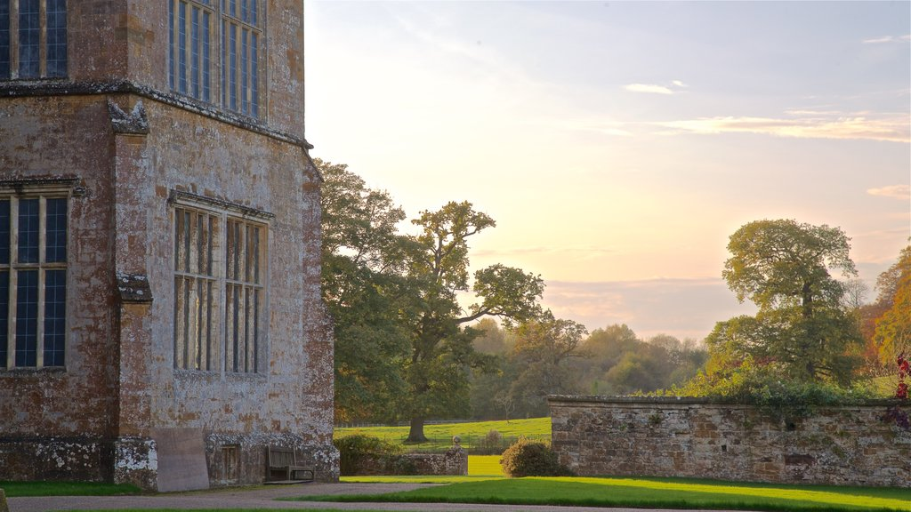 Broughton Castle featuring a garden, heritage elements and a sunset