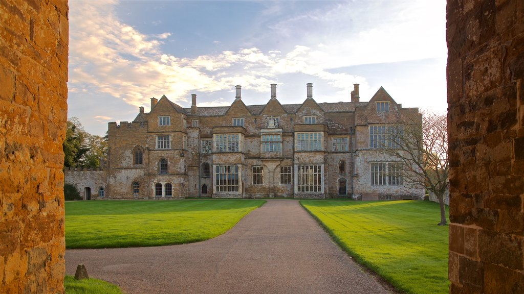 Broughton Castle featuring heritage architecture and a sunset