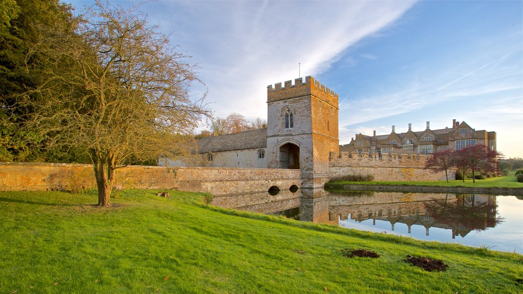 Broughton Castle which includes heritage architecture, a lake or waterhole and a castle