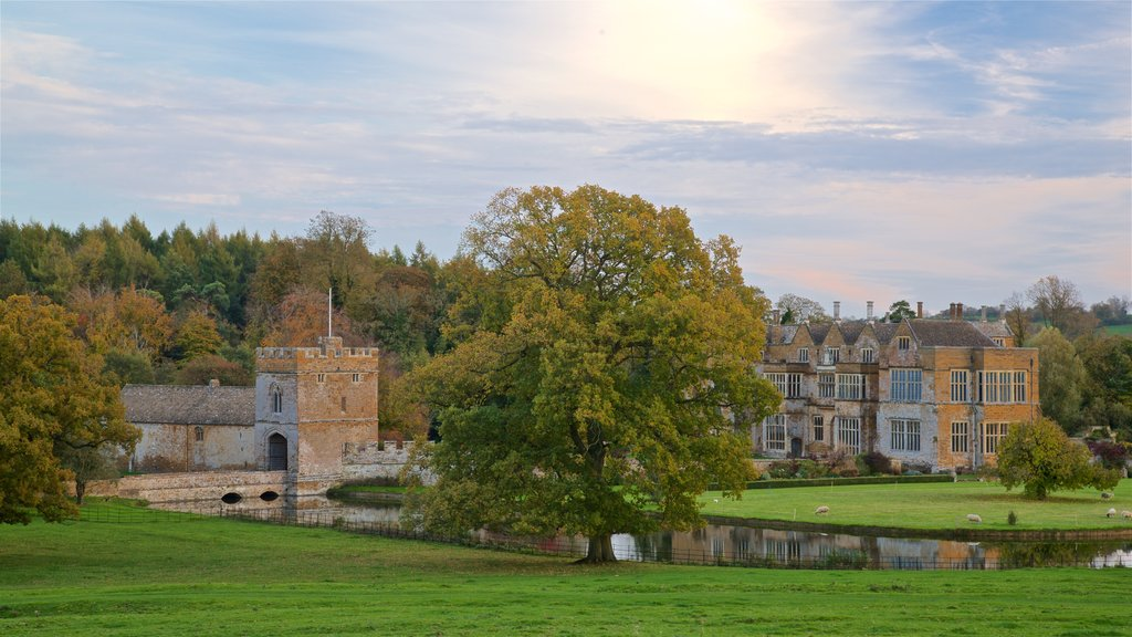 Broughton Castle showing a river or creek, a house and a sunset
