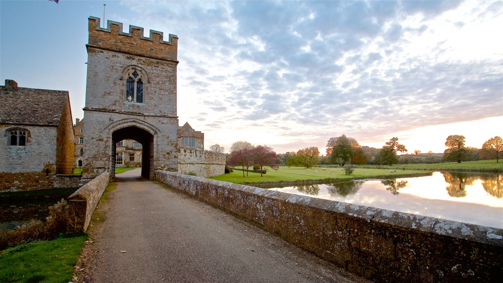 Broughton Castle showing heritage architecture, a sunset and a church or cathedral