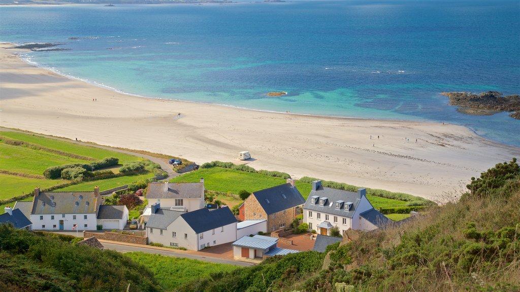 St Ouen showing a beach, a coastal town and landscape views