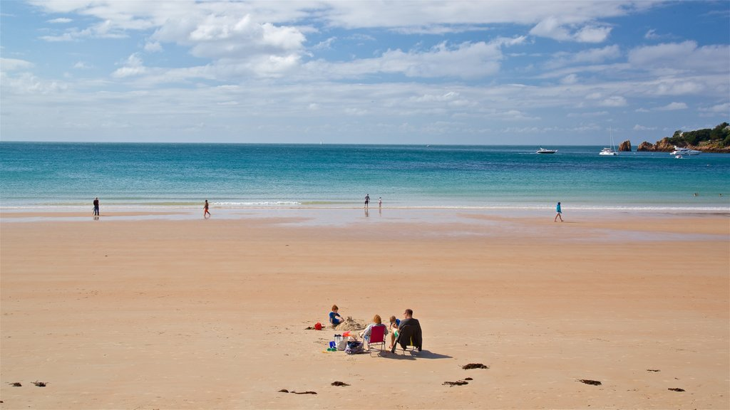 St Brelade\'s Bay Beach which includes general coastal views and a beach as well as a family