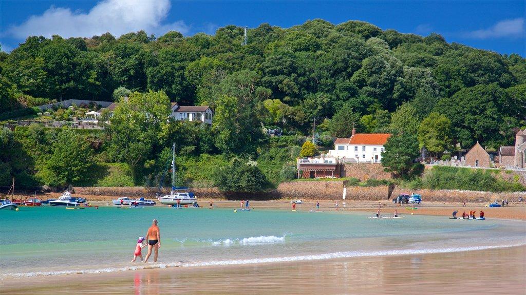 St Brelade\'s Bay Beach which includes a beach and general coastal views as well as a family