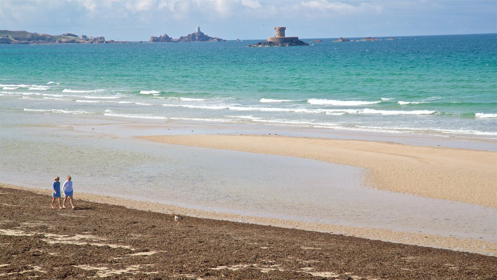 St Ouen showing general coastal views and a sandy beach as well as a couple