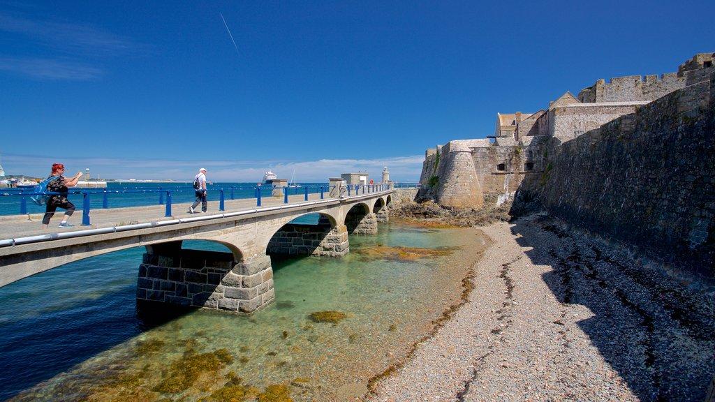 Castle Cornet featuring heritage elements, a bridge and general coastal views