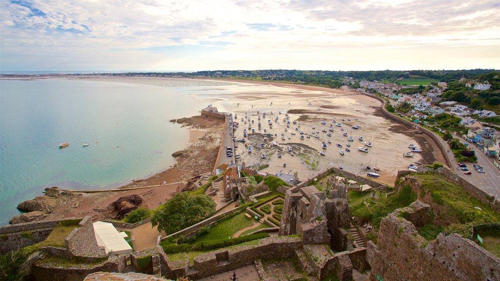 Mont Orgueil Castle which includes a beach, general coastal views and a ruin