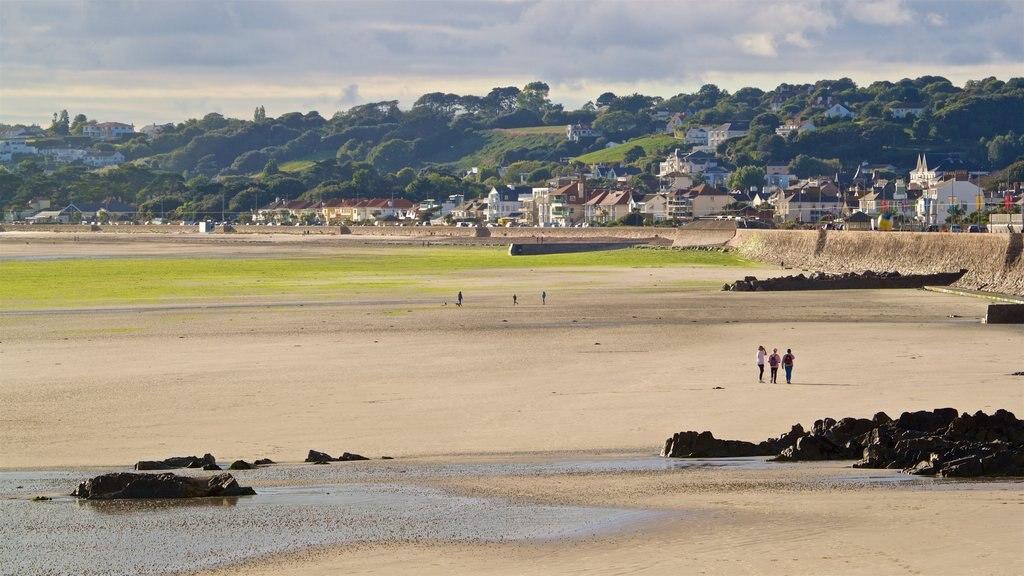 St. Helier Beach showing a beach, a coastal town and general coastal views