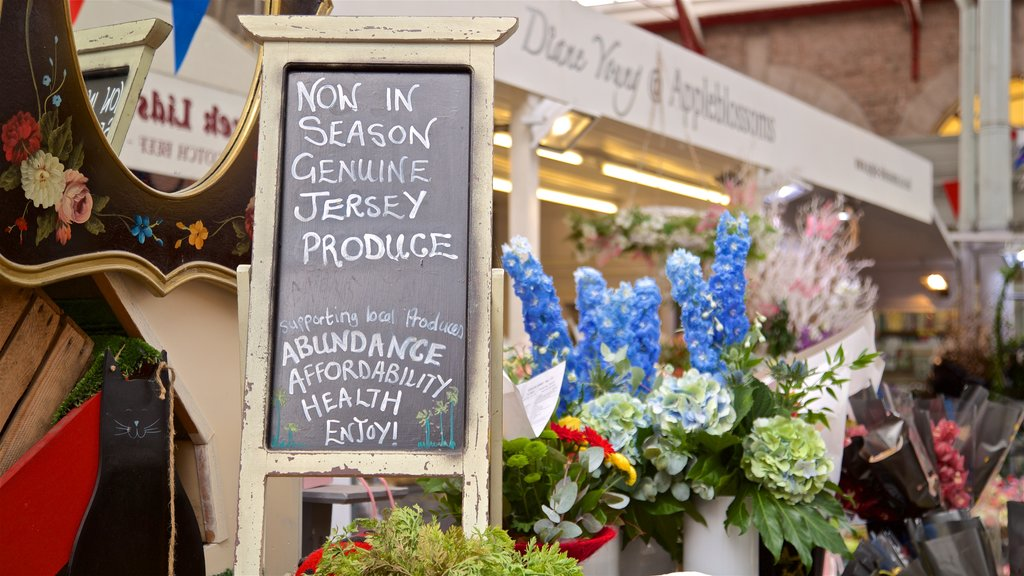 St. Helier Central Market showing signage, flowers and markets