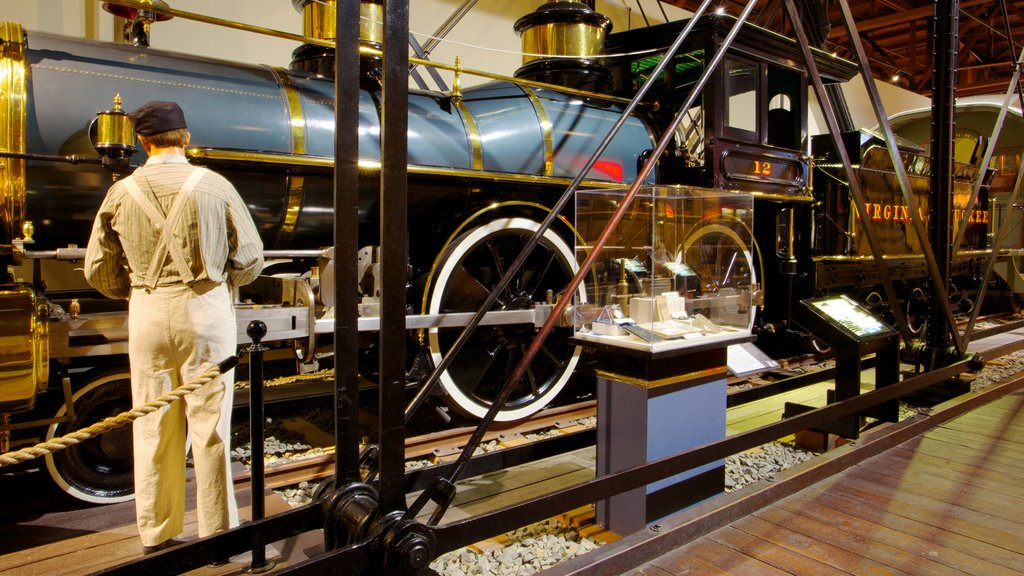 California State Railroad Museum showing railway items and interior views as well as an individual male