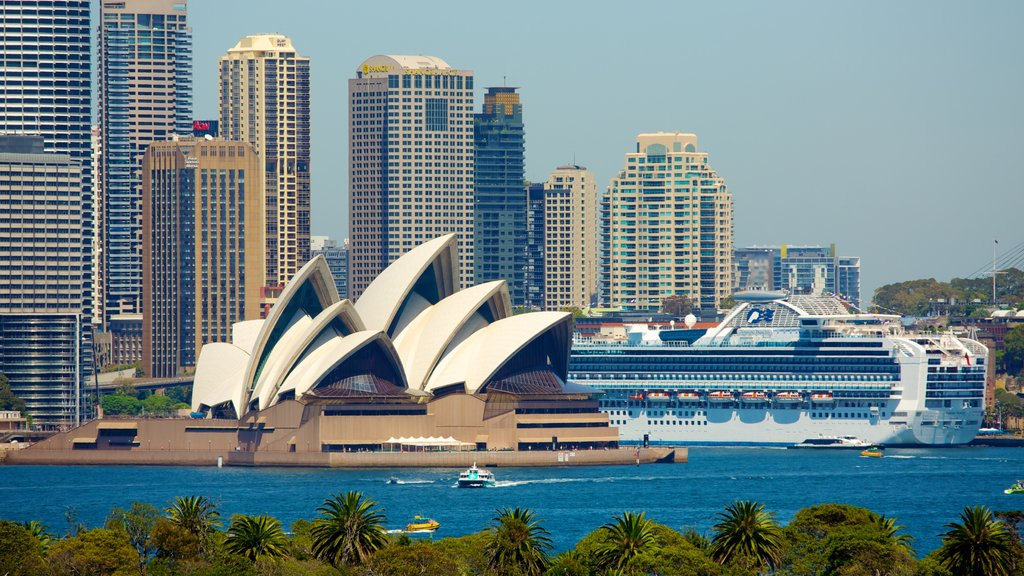 Sydney Opera House which includes cruising, a skyscraper and modern architecture