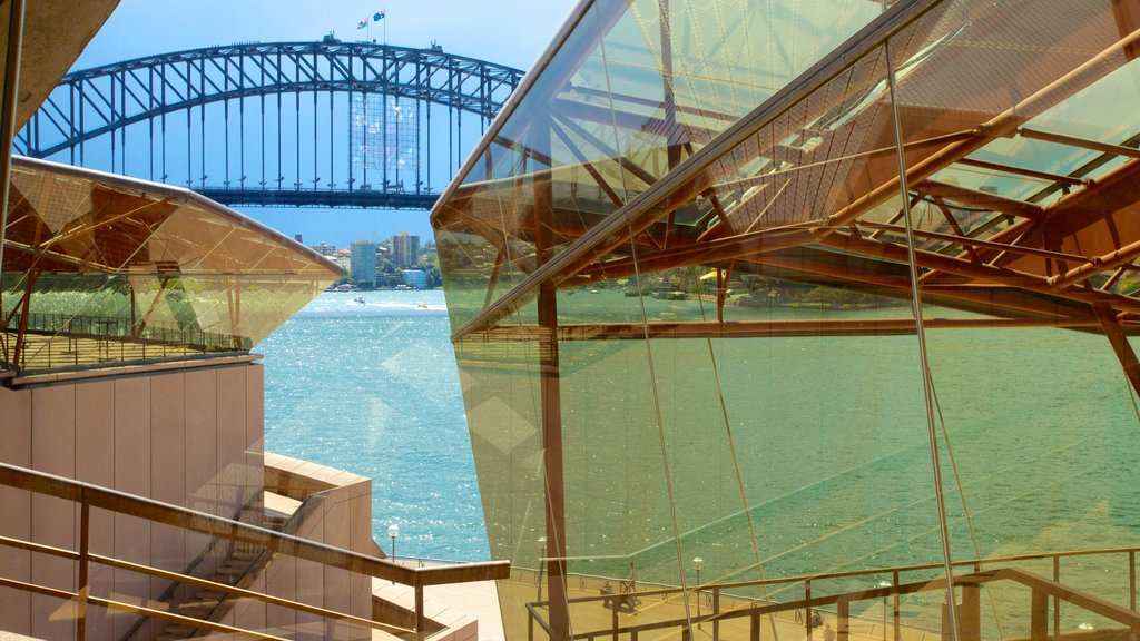 Sydney Opera House featuring a bay or harbor, modern architecture and theater scenes
