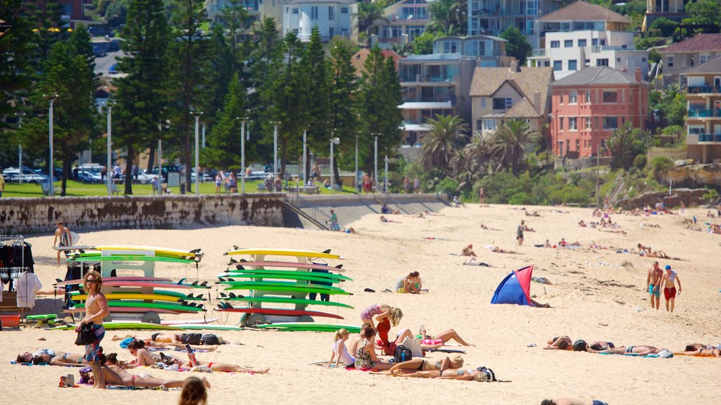 Manly which includes a beach as well as a small group of people
