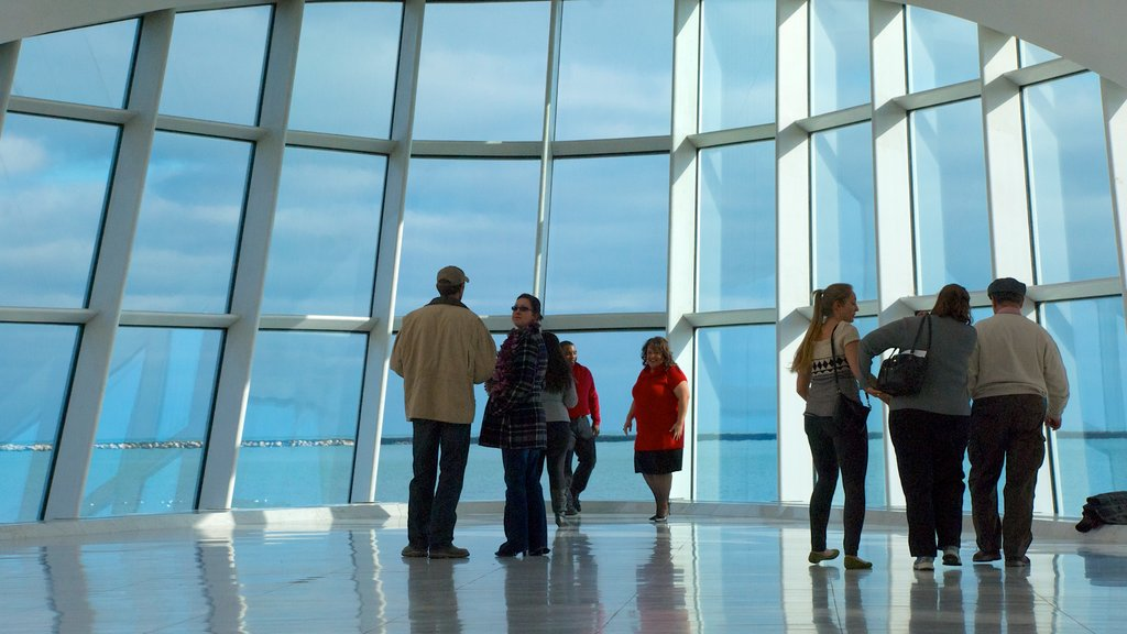 Milwaukee Art Museum featuring art and interior views as well as a small group of people