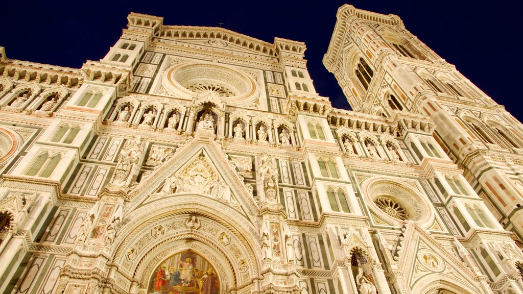 Piazza del Duomo which includes night scenes, heritage architecture and a church or cathedral