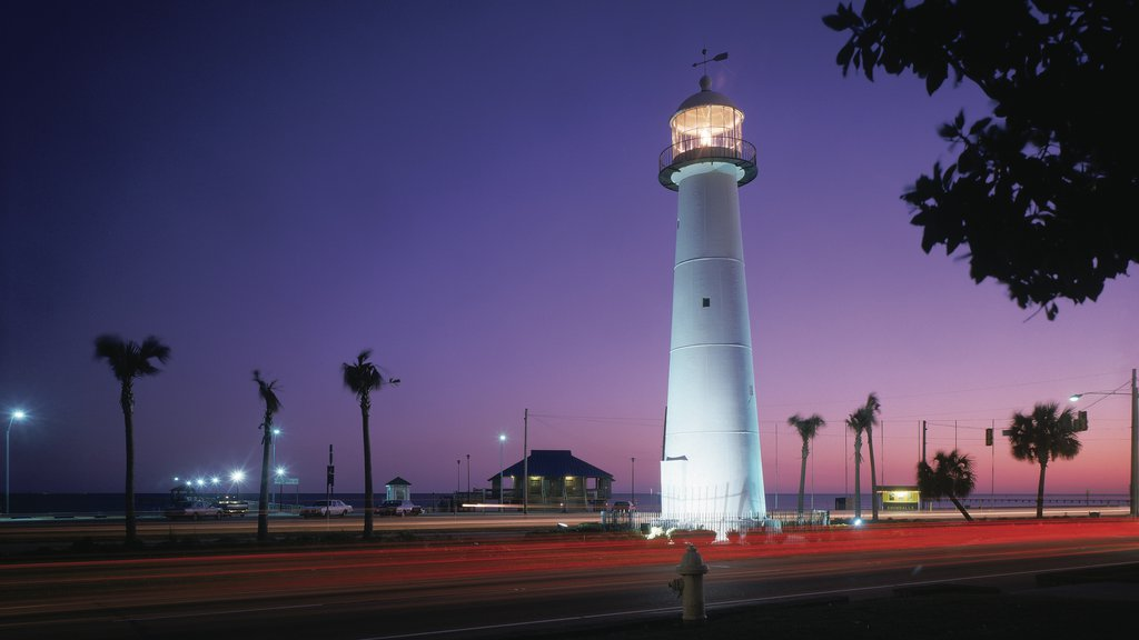 Biloxi featuring a lighthouse and night scenes