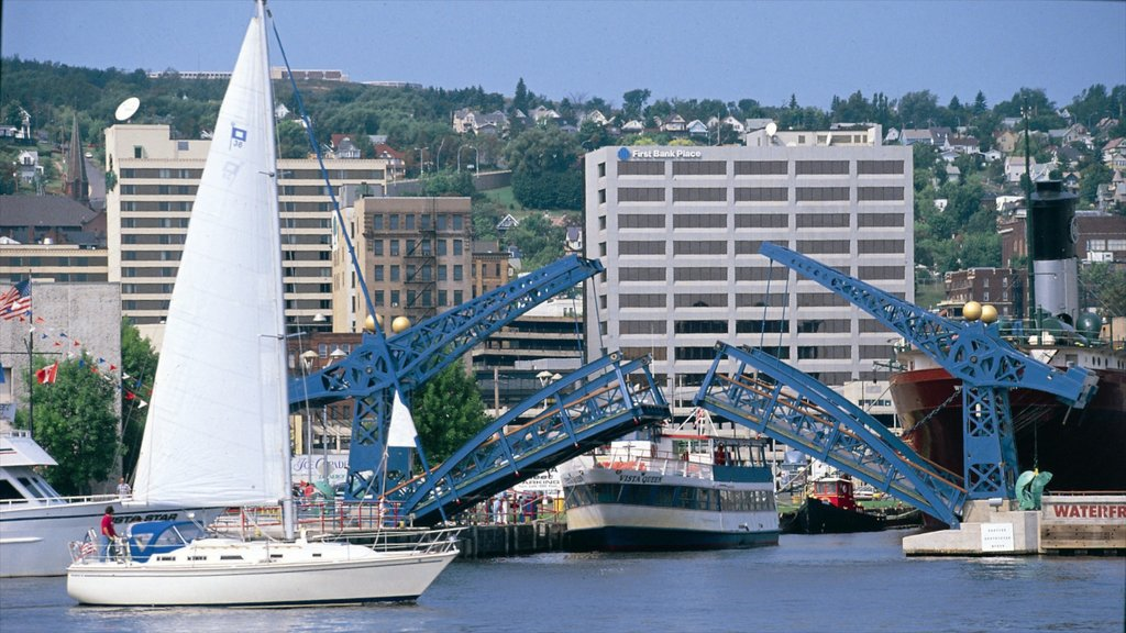 Duluth showing sailing, a coastal town and a bridge