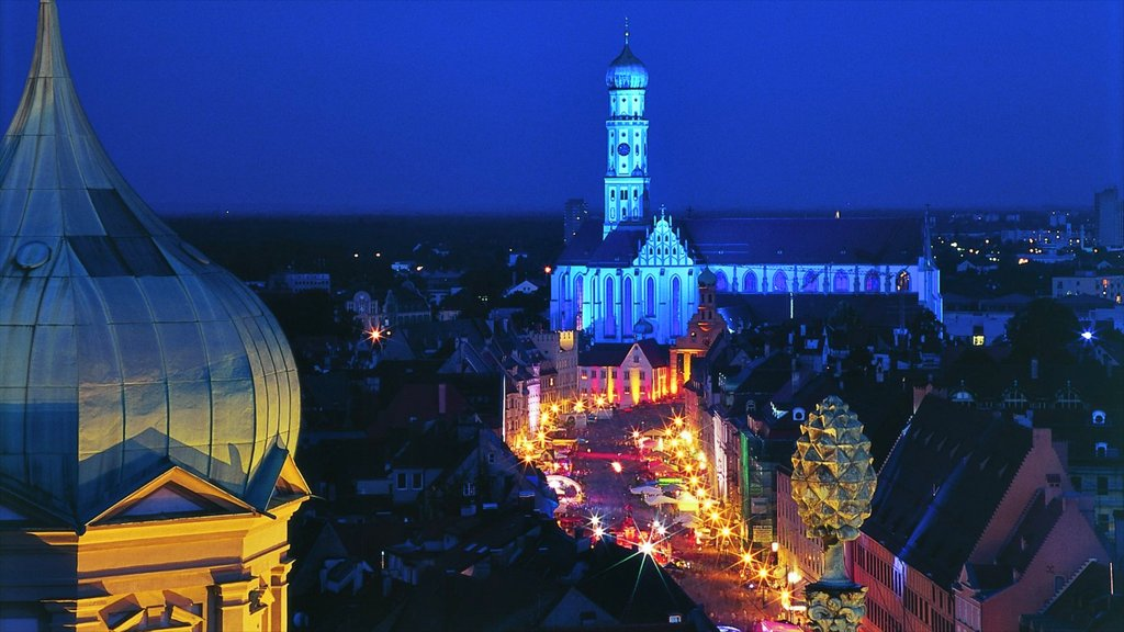 Augsburg showing a church or cathedral, heritage architecture and night scenes