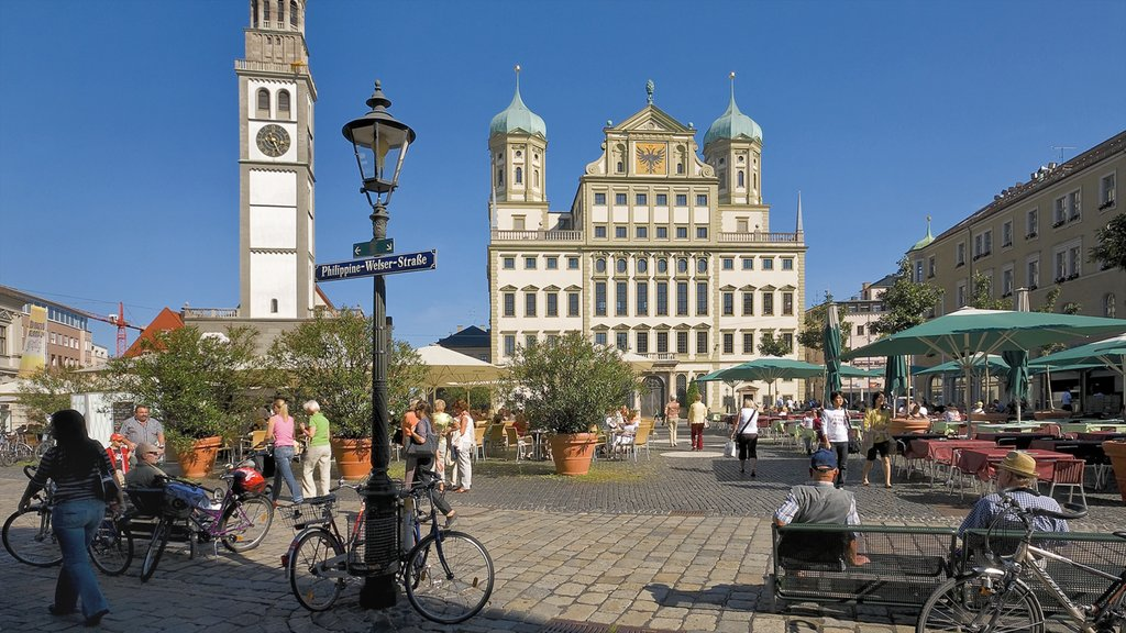 Augsburg which includes a city, a church or cathedral and a square or plaza