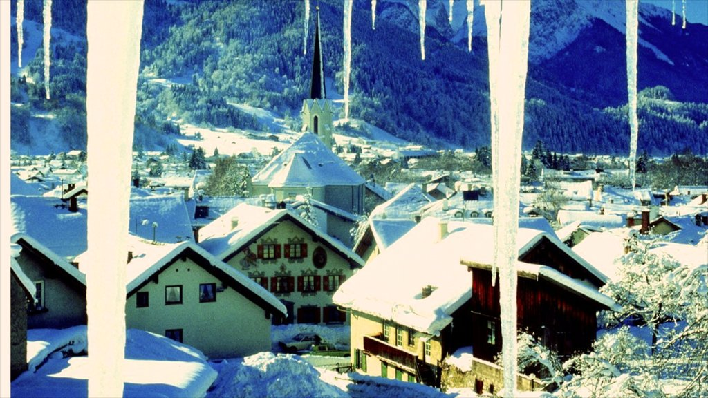 Garmisch-Partenkirchen featuring mountains, snow and a small town or village