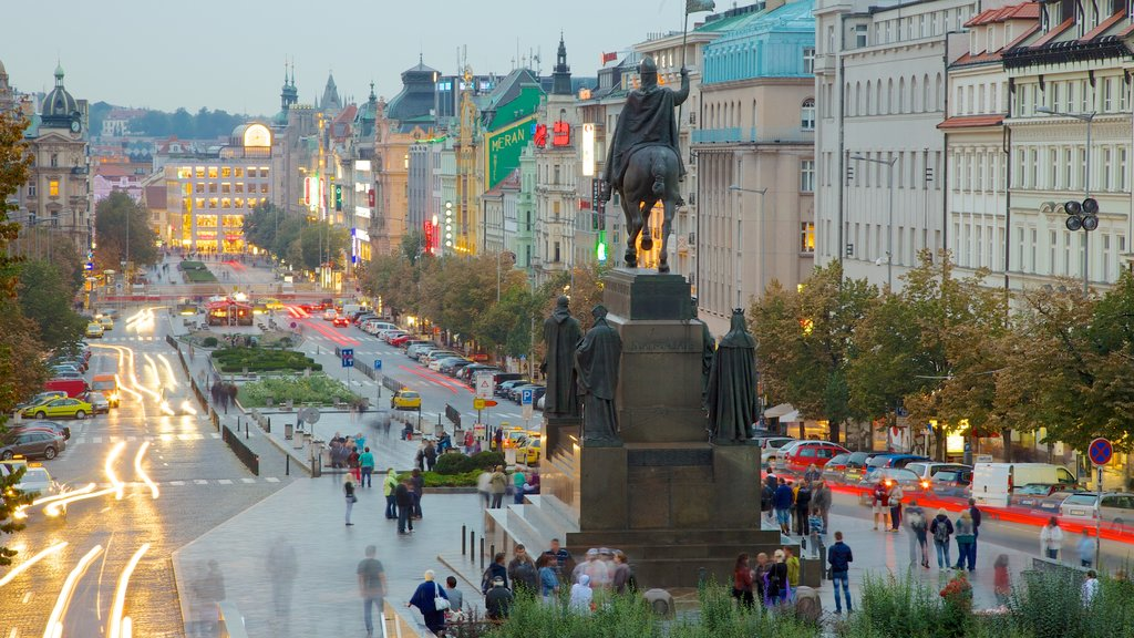 Wenceslas Square which includes a church or cathedral, city views and a monument