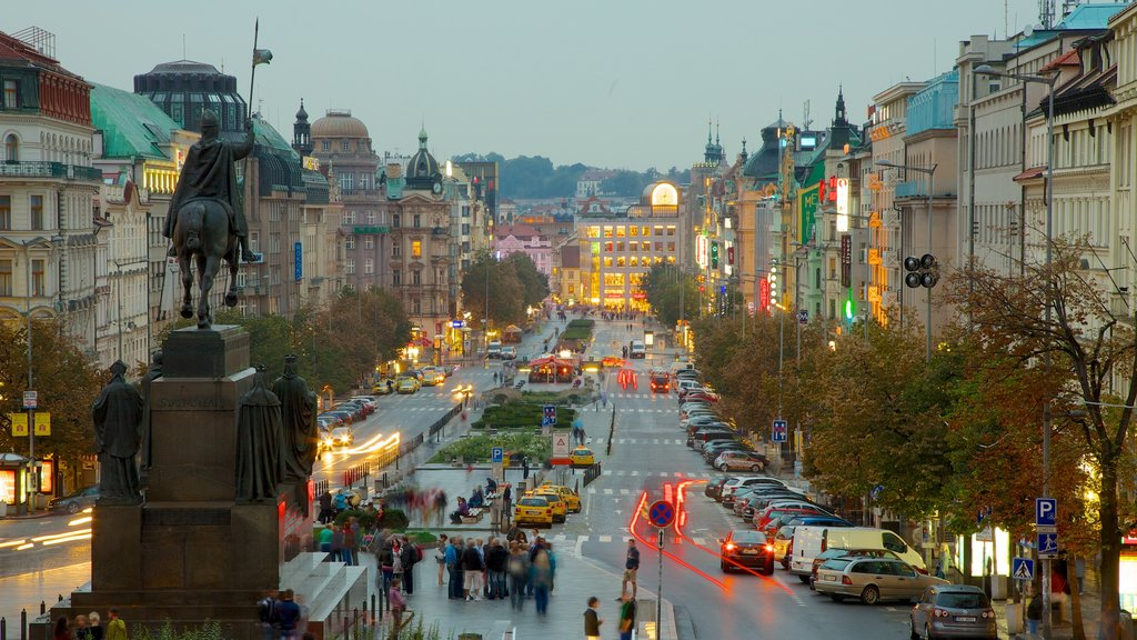 Wenceslas Square which includes a monument, a city and a statue or sculpture