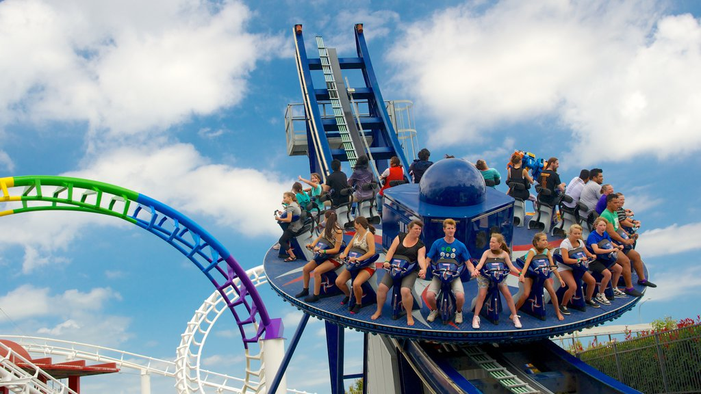 Rainbow\'s End showing rides as well as a large group of people