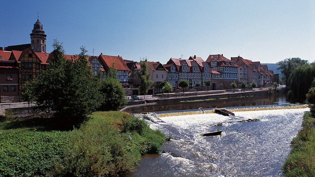 Kassel which includes a small town or village, heritage architecture and a river or creek
