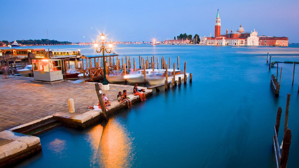 Small Islands of Venice showing night scenes and a bay or harbor as well as a small group of people