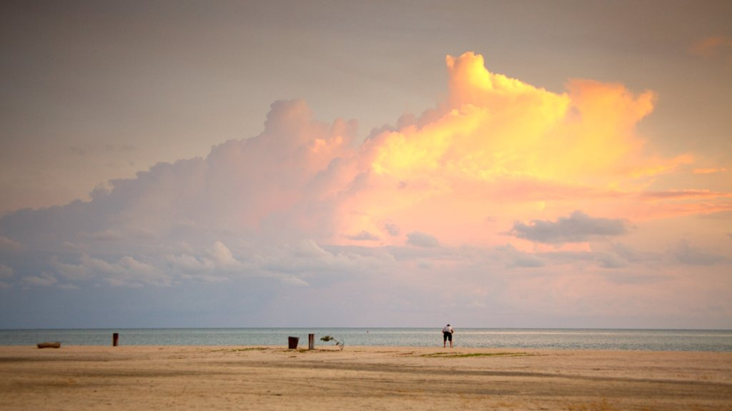 Langkawi showing landscape views, a sandy beach and a sunset