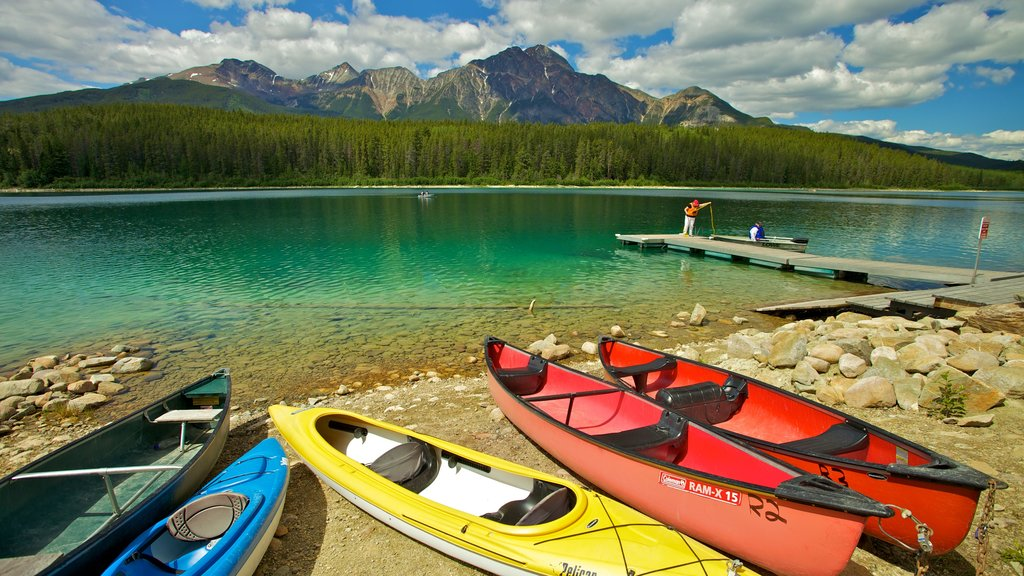 Patricia Lake which includes mountains, kayaking or canoeing and landscape views