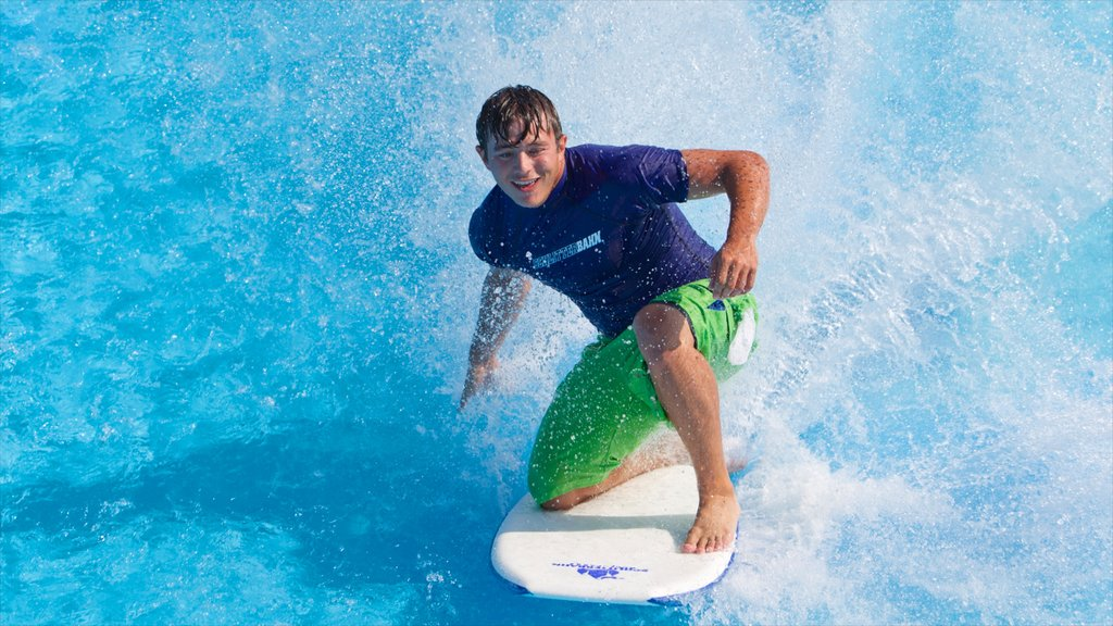 Galveston Schlitterbahn Waterpark showing waves and surfing as well as an individual male