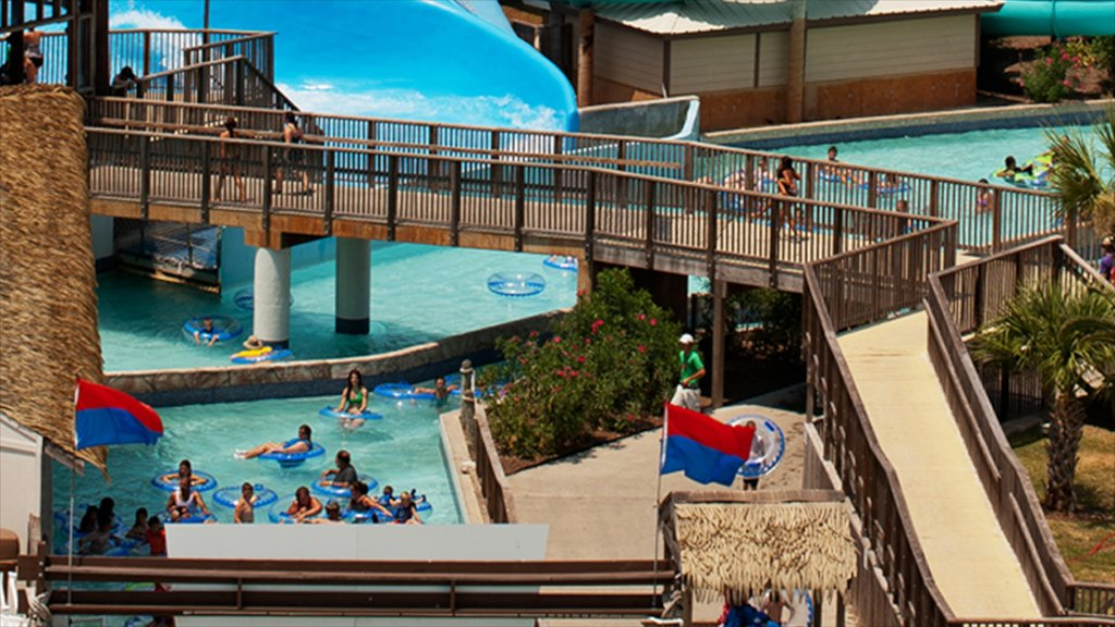 Galveston Schlitterbahn Waterpark which includes a pool, a waterpark and rides