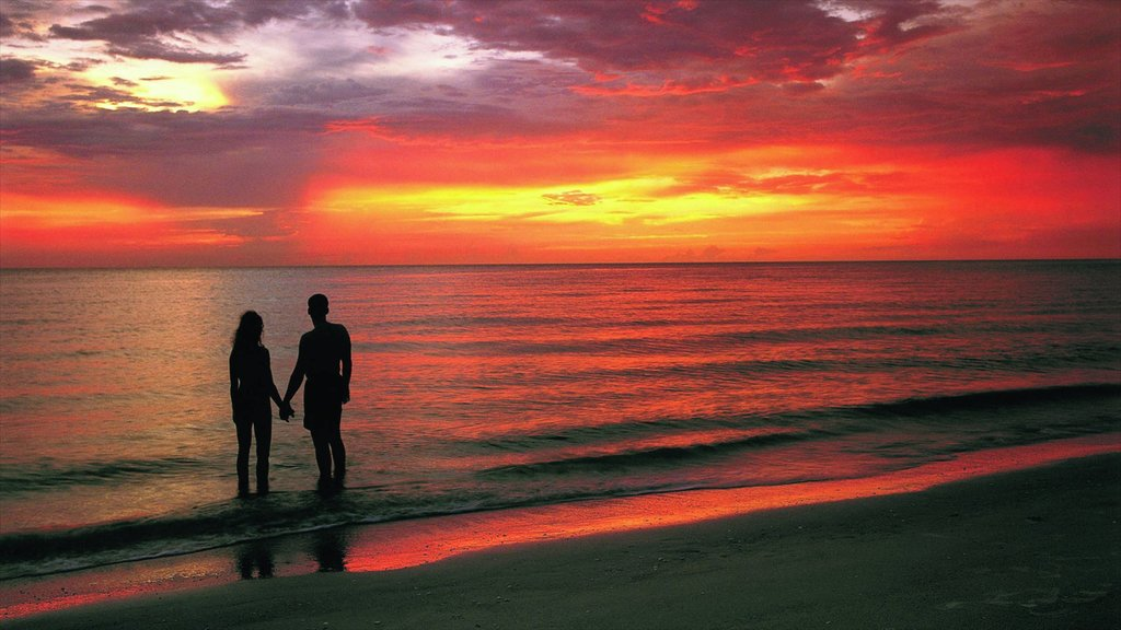 Clearwater Beach featuring a sunset, landscape views and a beach