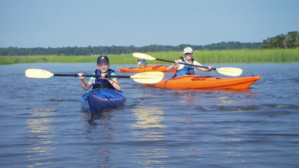 Tybee Island showing kayaking or canoeing as well as a family