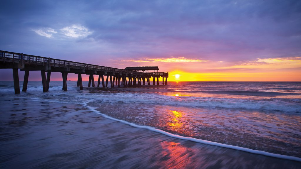Tybee Island showing a sandy beach, skyline and a sunset