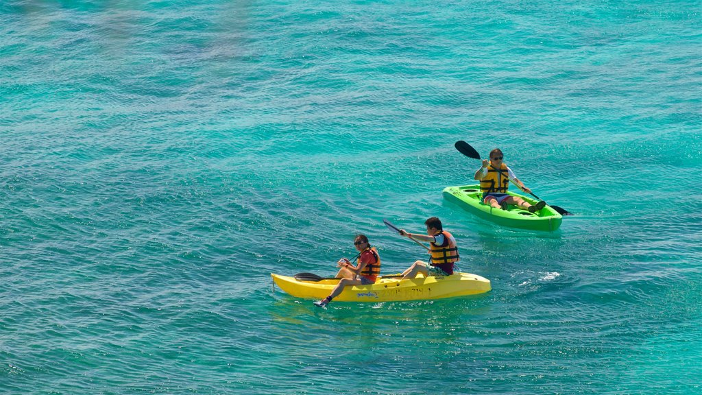 Isla Mujeres showing general coastal views and kayaking or canoeing as well as a small group of people
