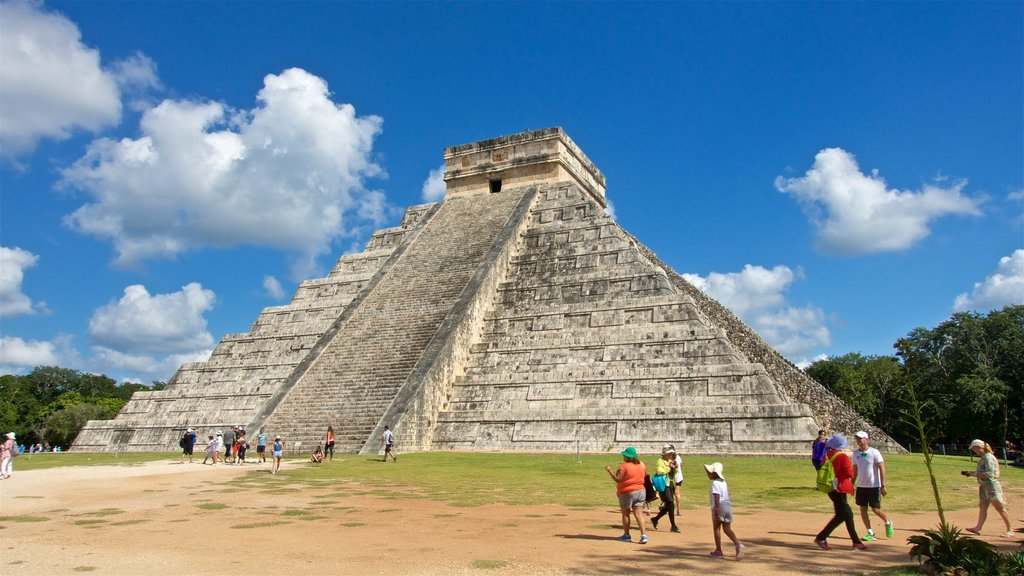 Chichen Itza featuring heritage architecture as well as a small group of people