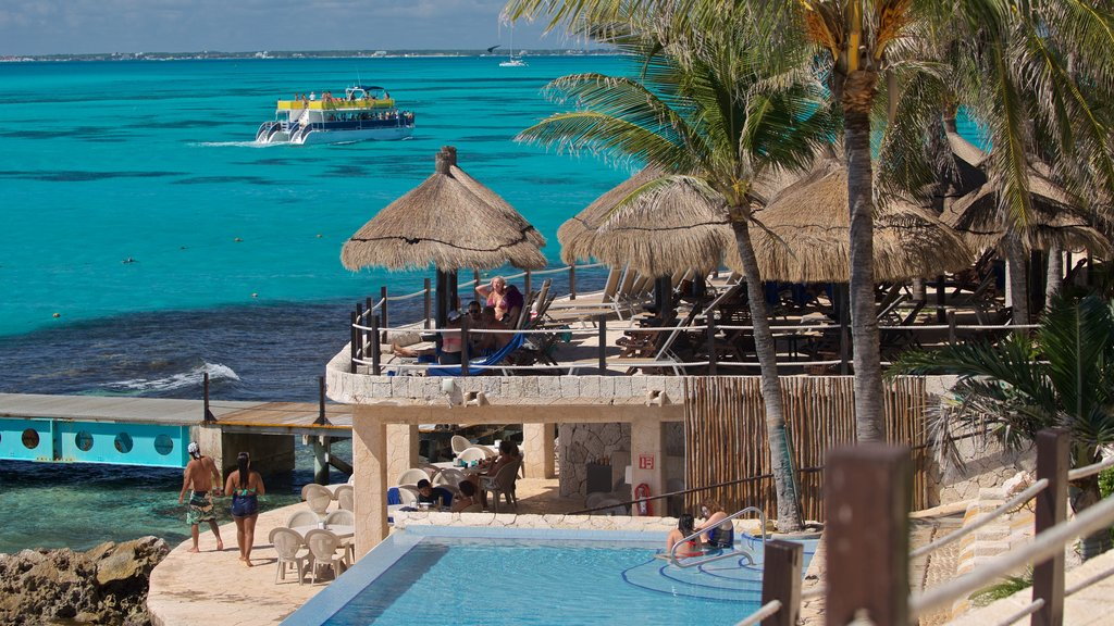 Isla Mujeres featuring a luxury hotel or resort, general coastal views and tropical scenes