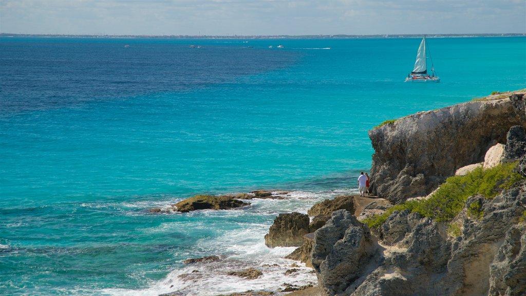 Isla Mujeres showing general coastal views, rugged coastline and sailing