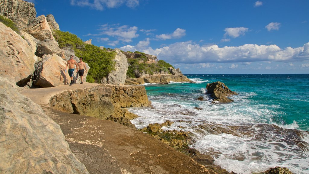 Isla Mujeres showing rugged coastline and general coastal views as well as a couple