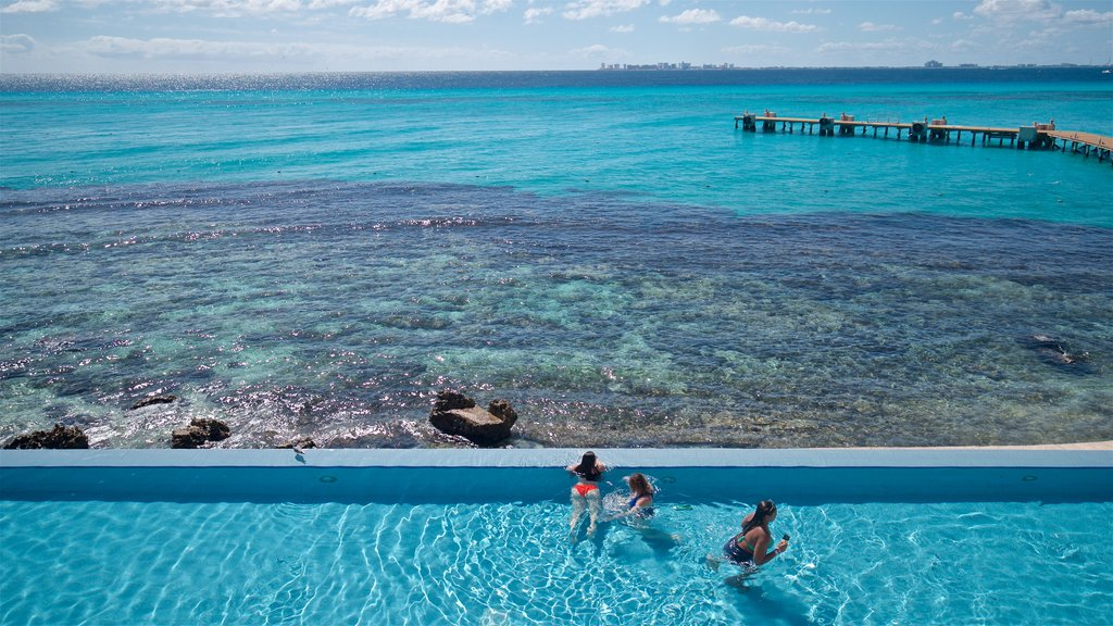 Garrafon Natural Reef Park featuring a pool, swimming and tropical scenes