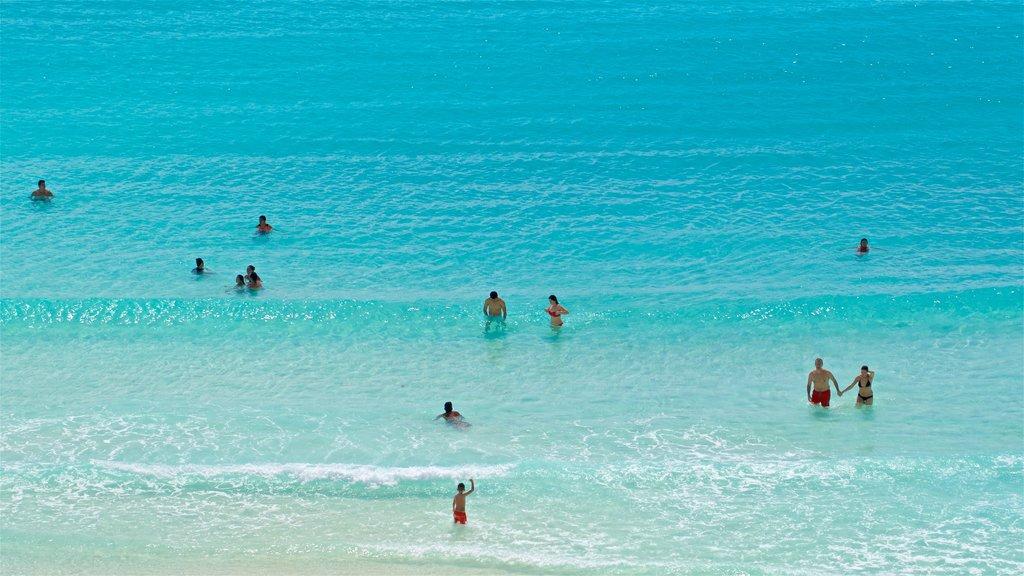 Gaviota Azul Beach which includes tropical scenes, general coastal views and swimming
