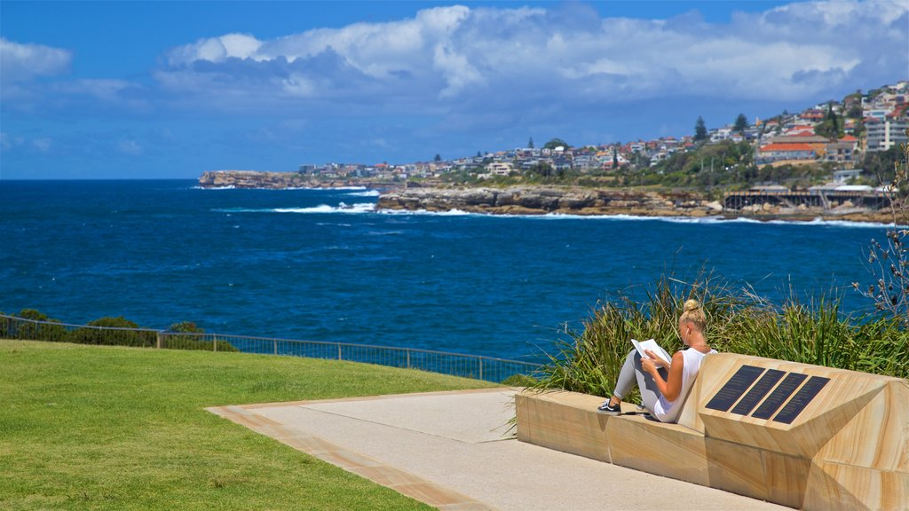 Coogee Beach which includes general coastal views and a coastal town as well as an individual femail
