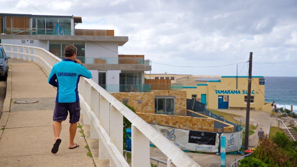 Tamarama Beach showing general coastal views and a coastal town as well as an individual male