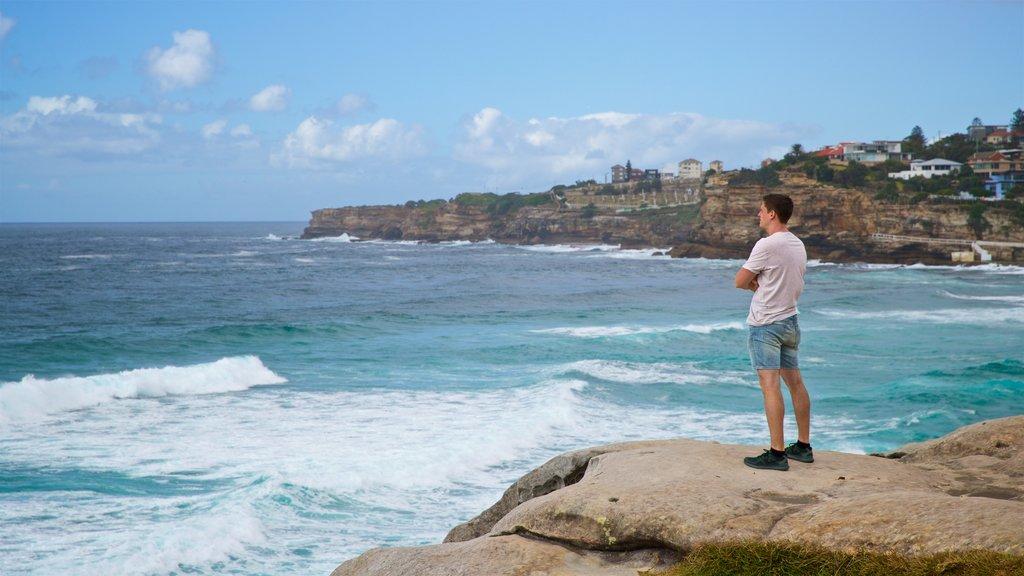 Tamarama Beach which includes general coastal views and rugged coastline as well as an individual male