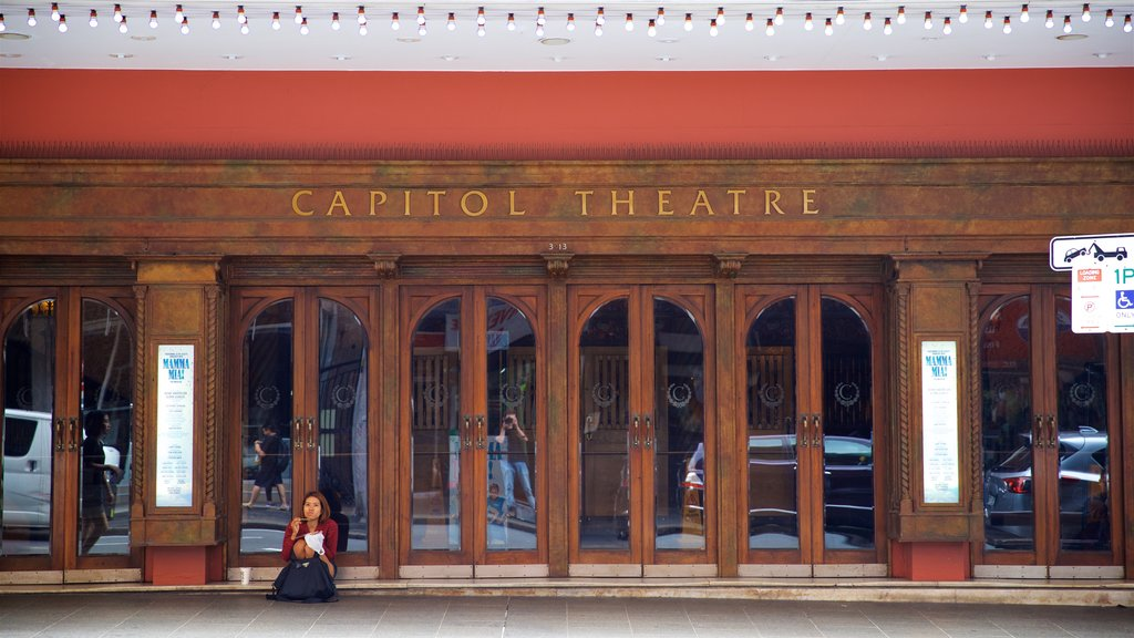 Capitol Theatre which includes signage as well as an individual femail