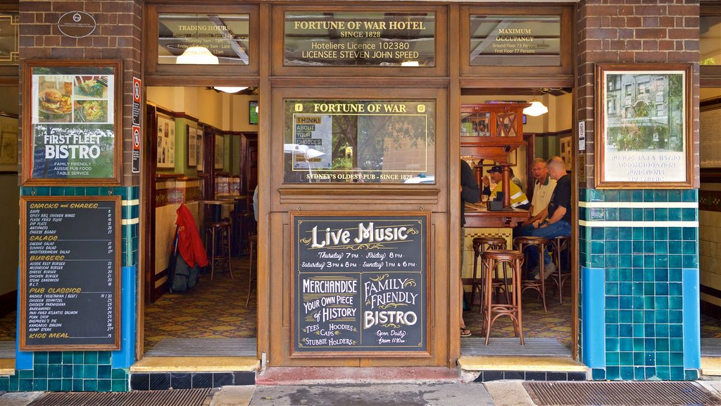 Sydney which includes a bar and signage