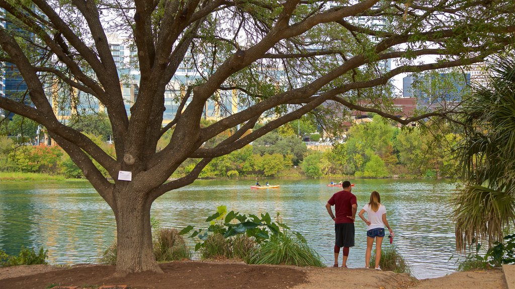 Austin featuring a lake or waterhole as well as a couple
