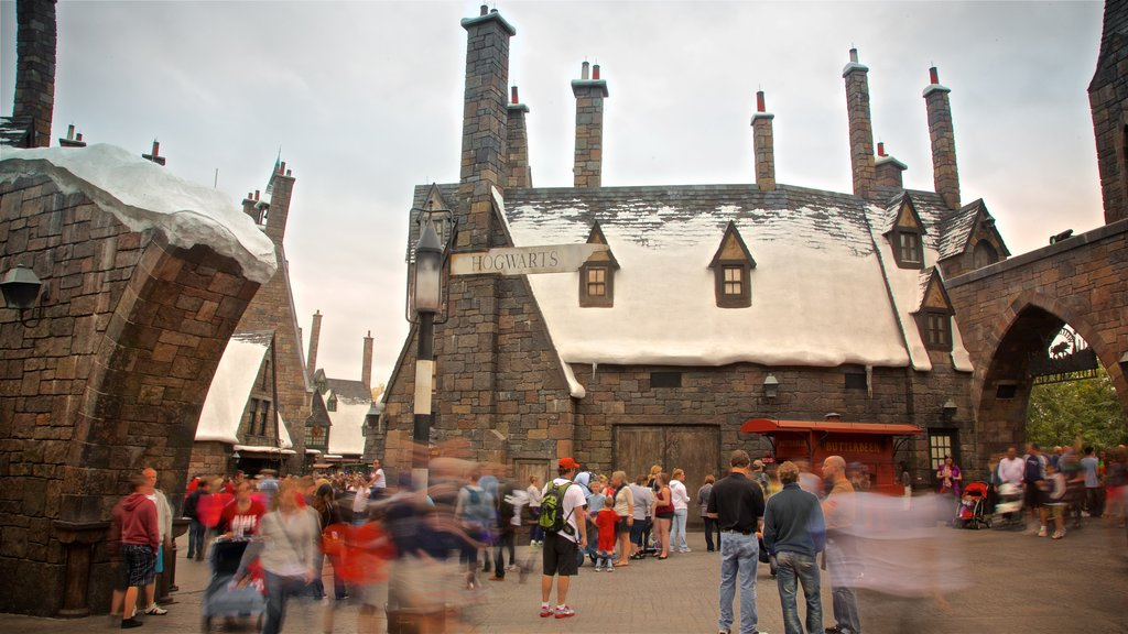 The Wizarding World of Harry Potter™ showing rides as well as a small group of people